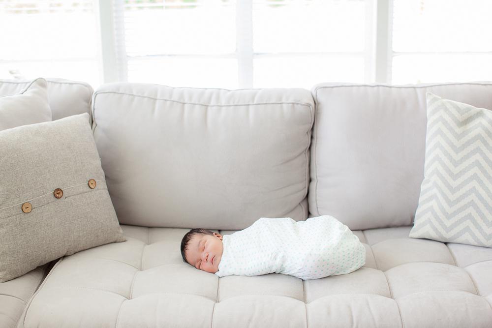 Orlando Lifestyle Newborn Photography baby swaddled